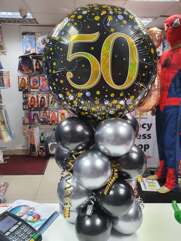Black and silver 50th birthday display