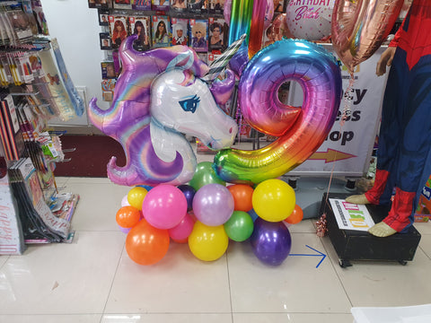 Rainbow Age Nine Unicorn balloon display