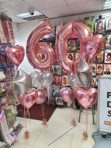 Rose gold and silver 60th birthday balloons