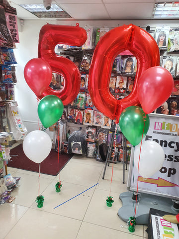 red green and white helium balloon display