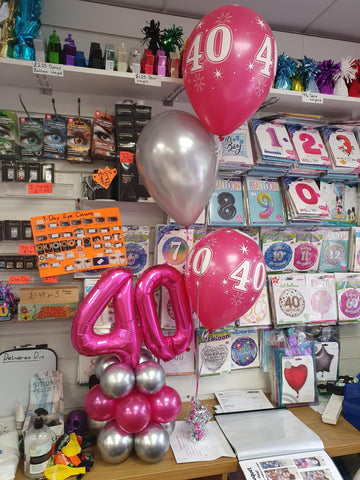 Pink and white 40th balloon bouquet and double number air-filled centrepiece