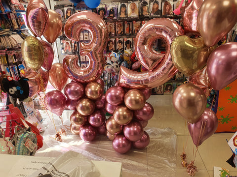 Rose gold latex and foil bouquets with 39th birthday columns