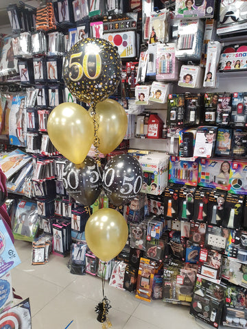 black and gold five balloon bouquet with 50th foil