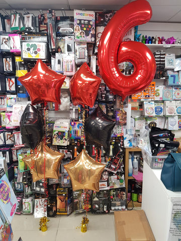 Red gold and black star three foil balloon bouquet