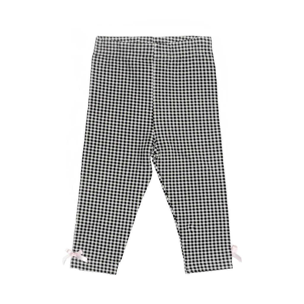 Girls houndstooth black and white patterned stretch legging pants with 3D pink bows on ankles
