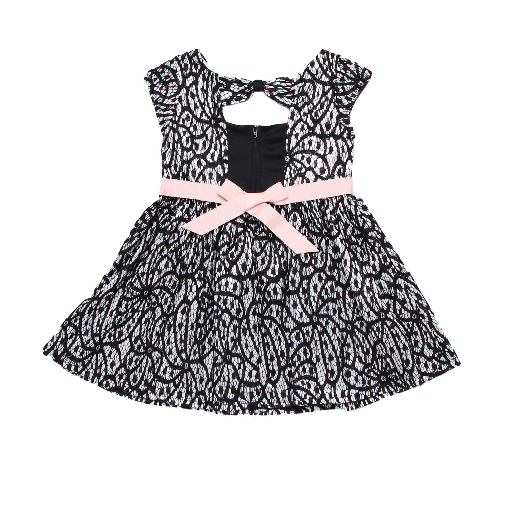 Back of toddler girls sleeveless fancy formal dress with white liner and black lace overlay with cutout and pink bow on waist