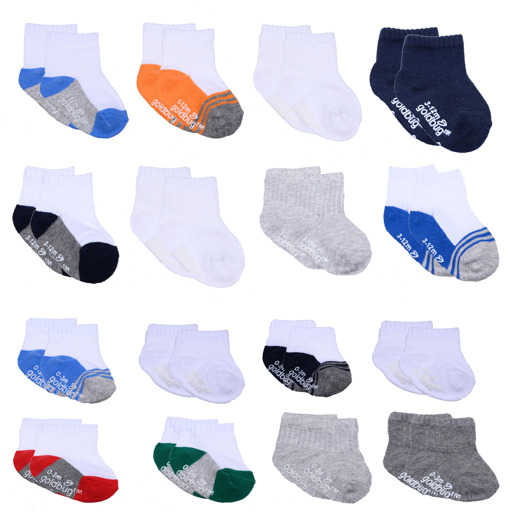 Baby and toddler boys 16 pack assorted gripper bottom ankle socks with different sizes to grow with baby in white and colors
