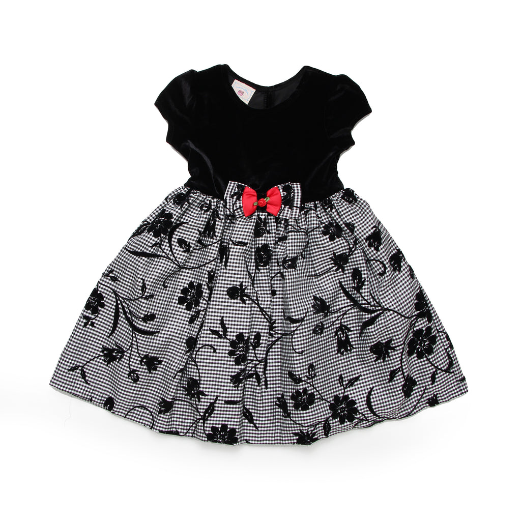 Little toddler girl formal fancy dress with cap sleeves and solid black velvet bodice over floral patterned skirt with 3D bow