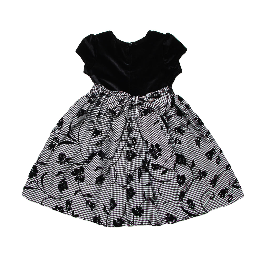 Back of little toddler girl formal fancy dress with cap sleeves and solid black velvet bodice over floral patterned skirt