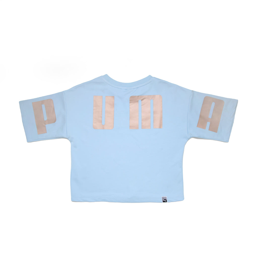 Back of girls PUMA oversized short sleeve crop top tee shirt in baby blue with PUMA logo in metallic rose gold across back