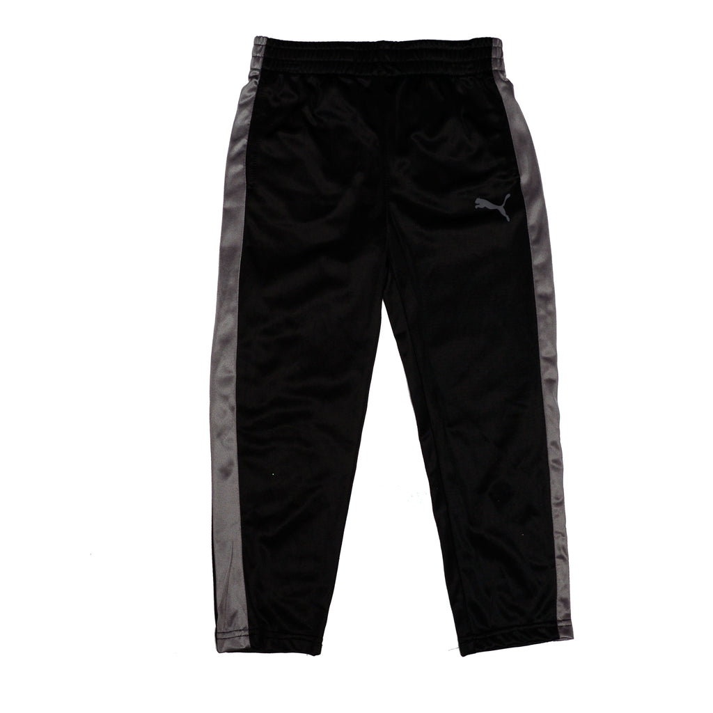 Boys black swishy polyester track pant sweatpant bottoms with grey athletic striping on side and PUMA big cat logo on leg