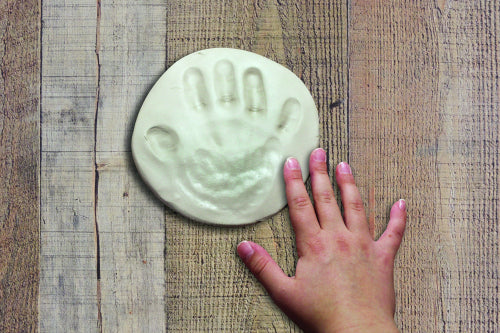 Work with damp hands when creating with air dry clay.