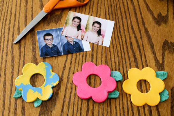 Cut a photo to fit on the back of the air dry clay flower.