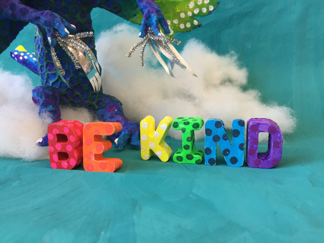 "PermaStone casted letters spell ""Be Kind"""