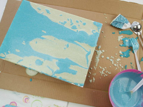 Allow excess sand paint to run off the edge of the canvas.  Allow to dry overnight.