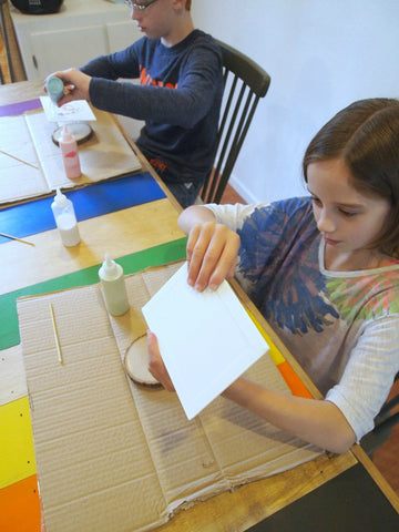 Kids can have fun making sand art paintings, too!