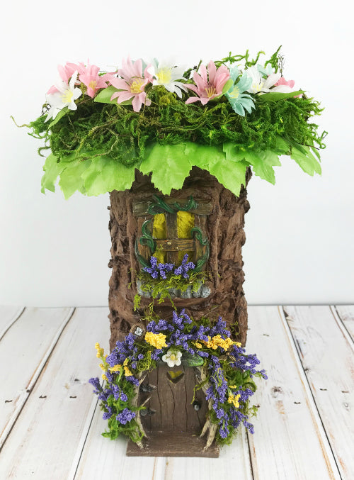 Add fake leaves and flowers to the fairy garden tree topper.