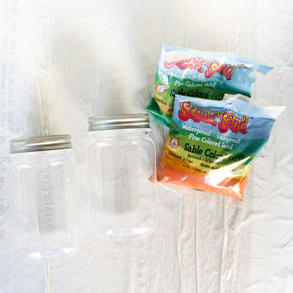 This Halloween craft project is so fun!  Create mason jar mummies candleholders for Halloween!
