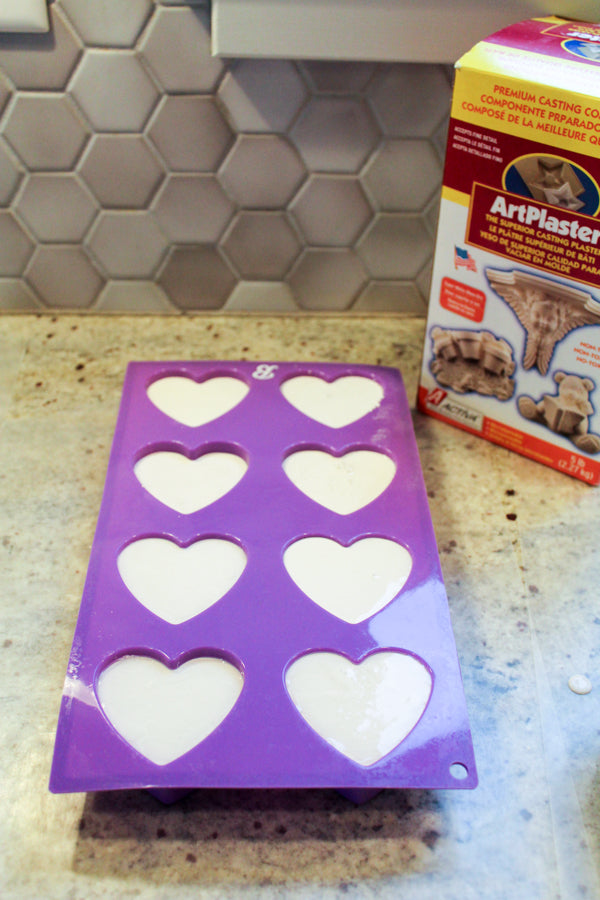 Pour ArtPlaster into a silicone mold to create heart-shaped kindness rocks.