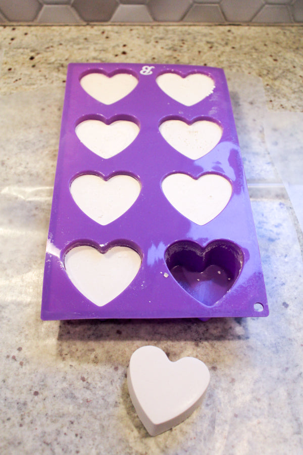 Remove ArtPlaster hearts from the silicone mold to begin working on your kindness rocks.