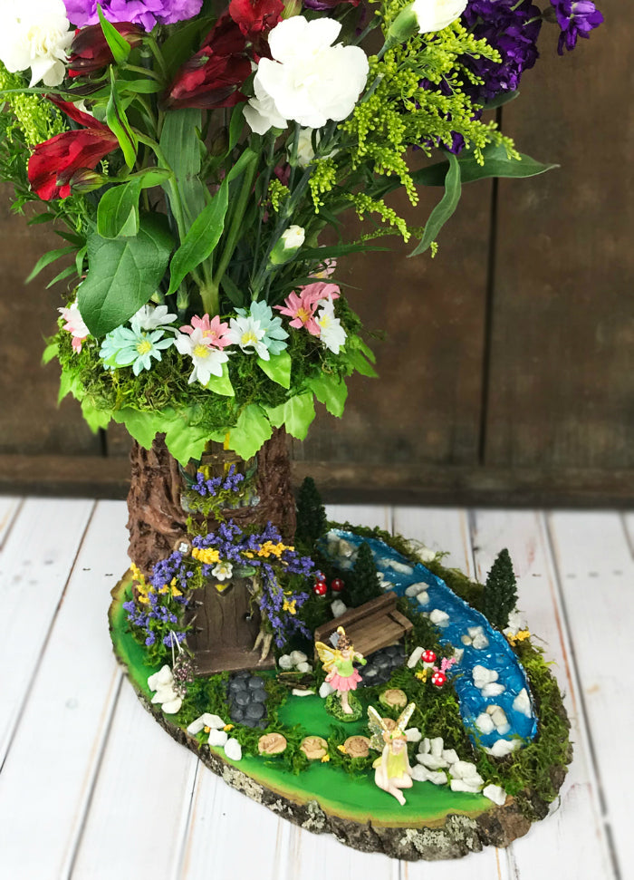 GORGEOUS!  Learn how to transform a florist's vase into a beautiful fairy garden tree vase!  This DIY fairy garden vase is absolutely stunning.  Get all of the project details in this post!