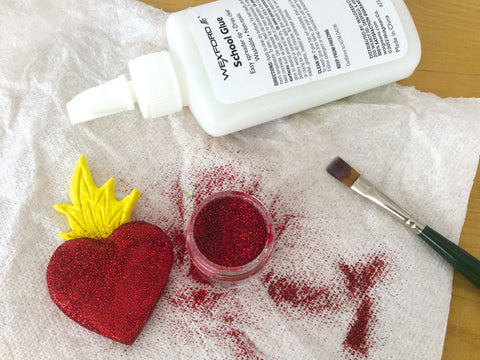 Learn how to make air dry clay sacred heart magnets.
