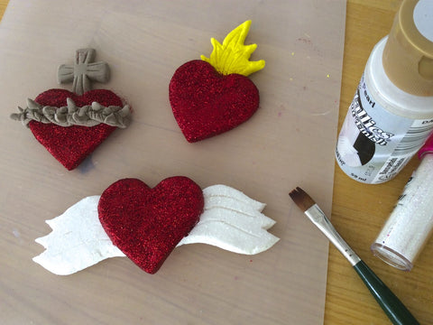 Make air dry clay sacred heart magnets.