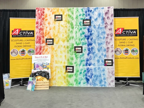 This colorful sand painting technique is a DIY rainbow trade show backdrop!
