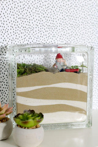 An indoor fairy garden is a fantastic project to make with kids or adults!  Use Scenic Sand to create a beautiful layered look.