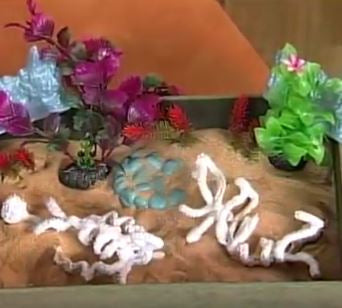 Plaster Cloth, Artplaster & Colored Sand are used to make Dinosaur fossils on Hands On Crafts for Kids -
