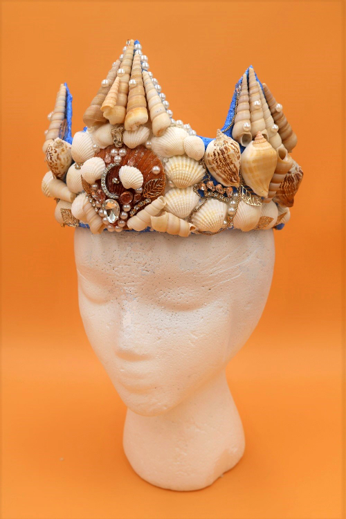 Learn how to make a beautiful DIY mermaid crown with real seashells!  This project is also a great way to use up old jewelry!