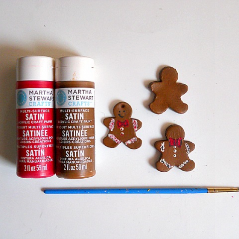 painting the clay ginger bread men