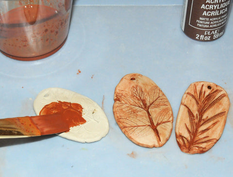 painting and sealing air dry clay pendant