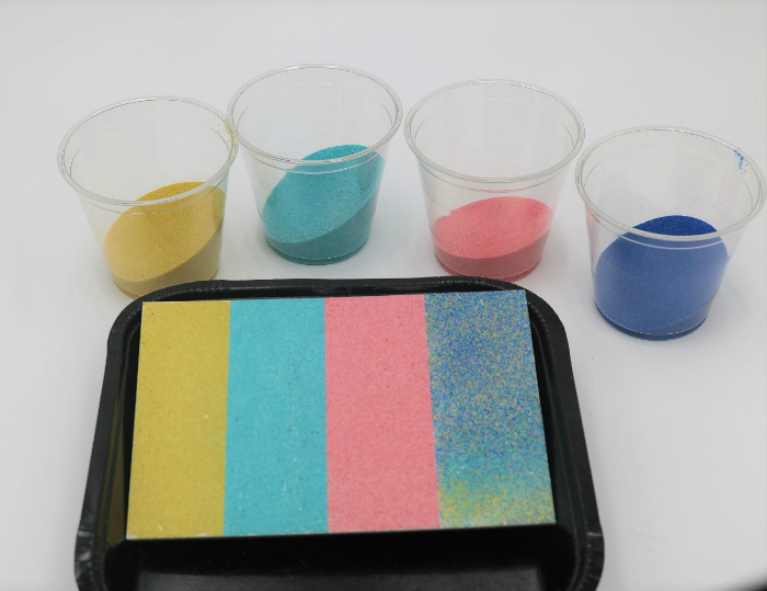 It's easy to create mess-free sand art with adhesive boards.