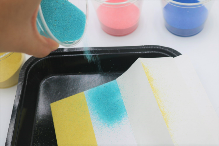It's easy to create beautiful sand art with adhesive boards.