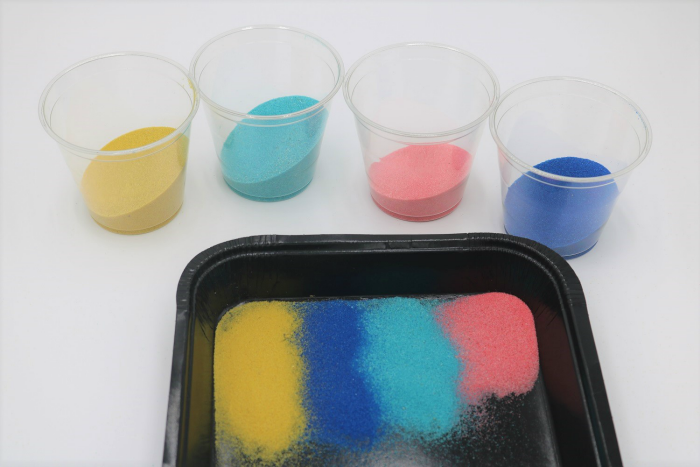 It's easy to create gorgeous colored sand art with adhesive or sticky boards.
