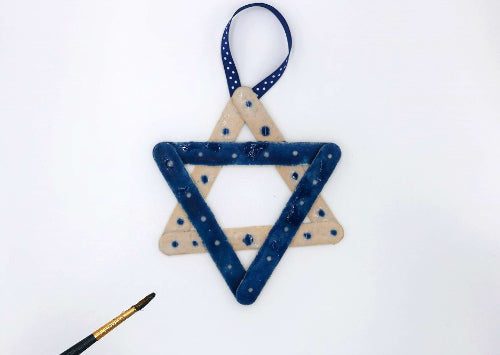 Create a Star of David ornament for Hanukkah with colored sand and glue!  #HanukkahCrafts #Hanukkah
