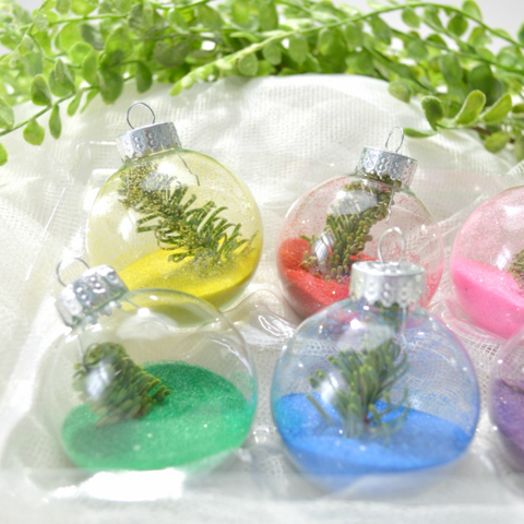 selection of colored sand ornaments with decorations