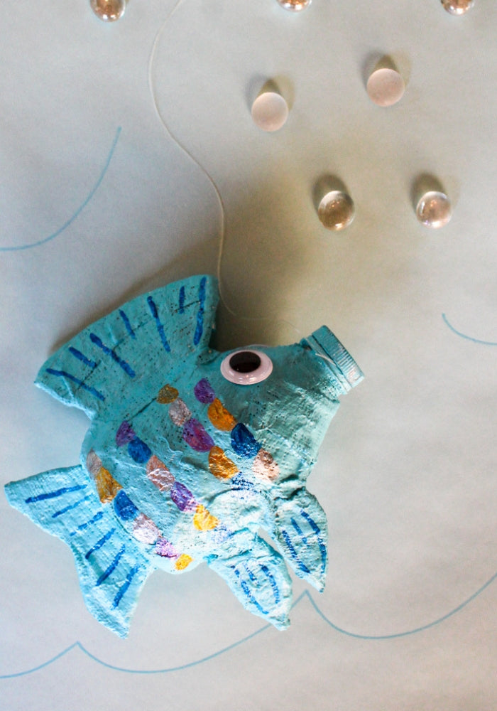 Make a fish sculpture with an empty water bottle and Rigid Wrap plaster cloth!  This free lesson plan will show you how to use water bottles as armatures to create fun projects for the art room.  #armature #fishsculpture #lessonplan