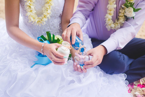 It's easy to plan the perfect wedding unity sand ceremony!  Find out what supplies you need for a wedding unity sand ceremony right here.