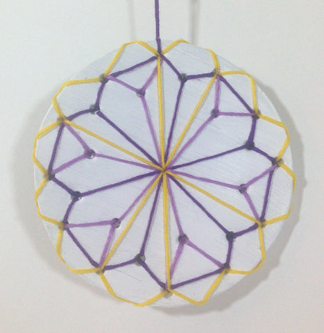 hanging white air drying clay mandala