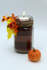 Create a pretty candle arrangement with colored craft sand for fall.