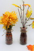 Add color to fall floral arrangements with colored craft sand in fall shades.