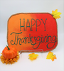 Use red and orange colored sand and adhesive boards to create pretty sand art decor for your Thanksgiving celebration.