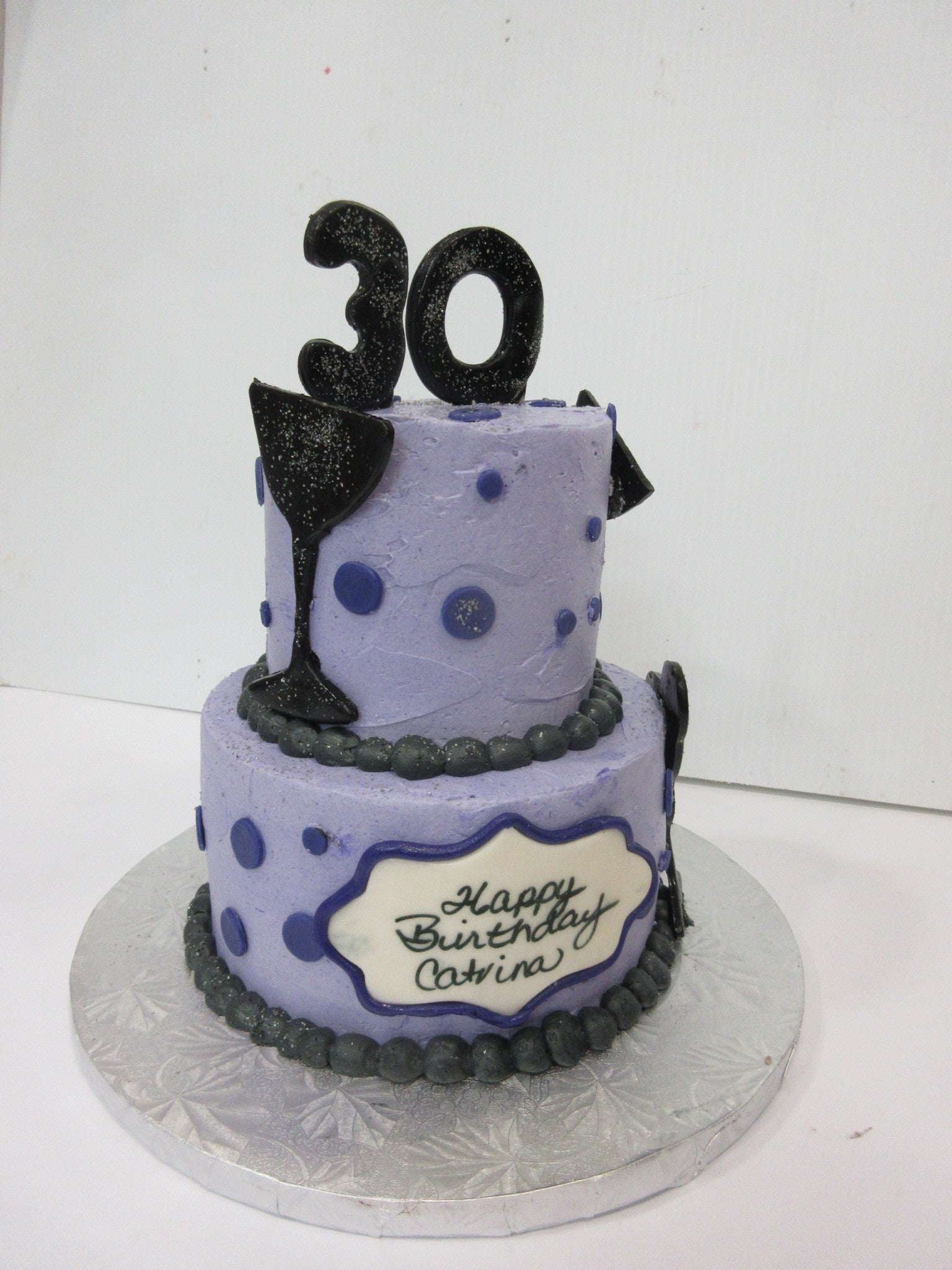 2-tier Buttercream cake with fondant accents
