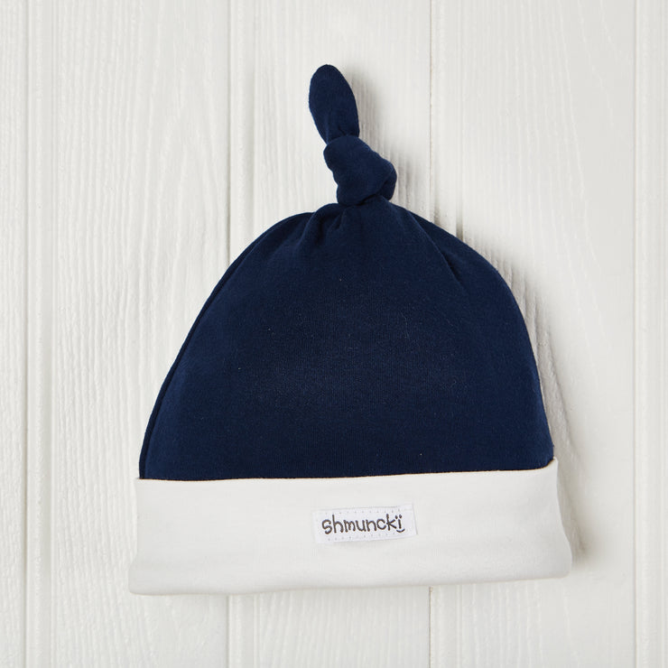 navy baby boy knotted hat with cream trim