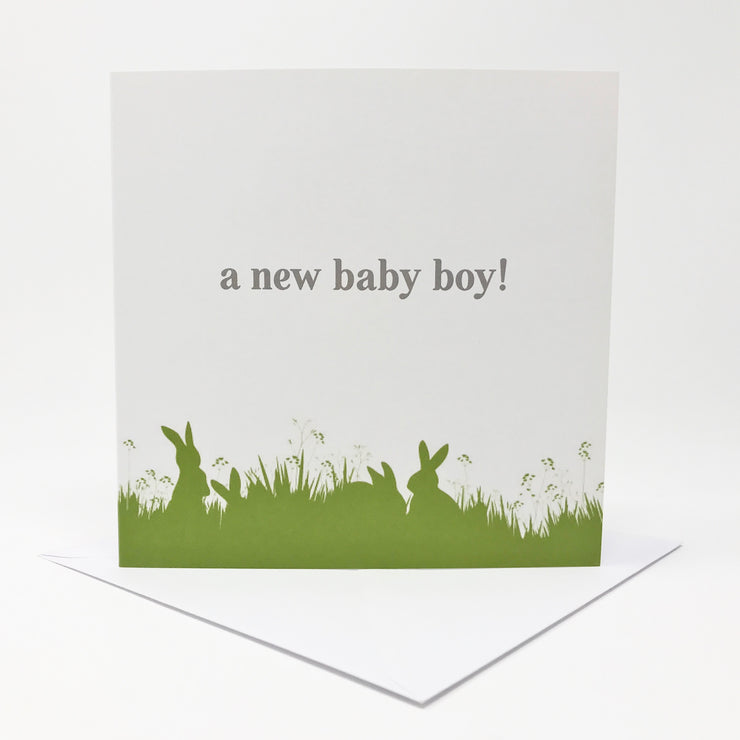 a new baby boy card with green bunny illustration at the base