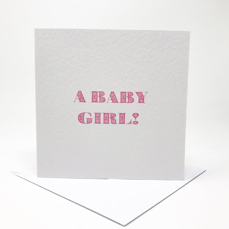a baby girl! New arrival card in pink flower letters