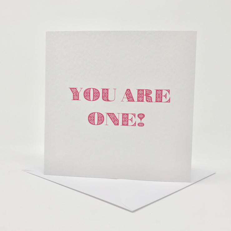 First birthday card for a girl with you are one in pink letters with free delivery to UK