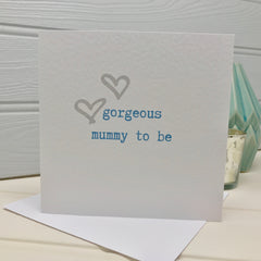 'gorgeous mummy to be' baby shower card in blue with hearts